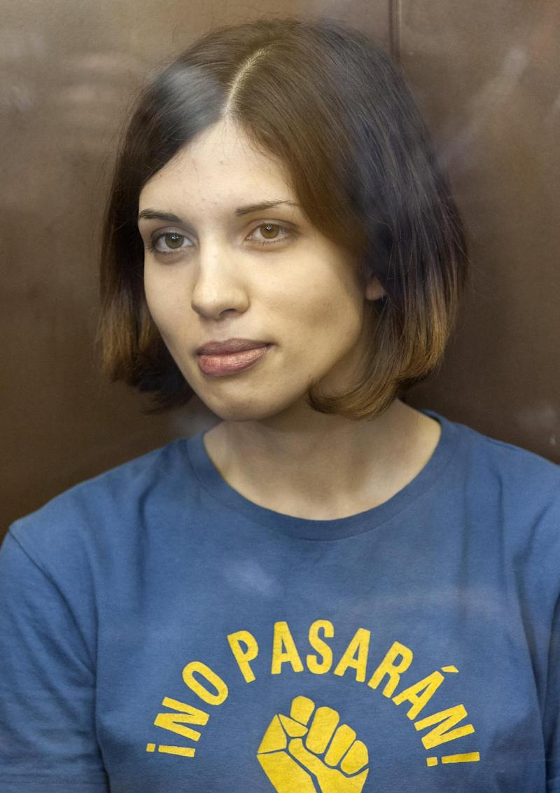 """FILE - In this Aug. 17, 2012 file photo, Feminist punk group Pussy Riot member Nadezhda Tolokonnikova sits in a glass enclosure at a court in Moscow, Russia. Federal Prison Service spokeswoman Kristina Belousova said Friday, Feb. 1, 2013 that Tolokonnikova is in a prison hospital in the province of Mordovia in western Russia, the site of her prison colony. Belousova refused to specify Tolokonnikova's illness or comment on her condition, saying only that she has """"nothing serious."""" (AP Photo/Misha Japaridze, File)"""