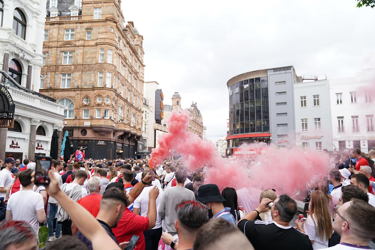 England fans partying in Leicester Square, central London, ahead of the England football team playing in the UEFA Euro 2020 Final. Picture date: Sunday July 11, 2021.