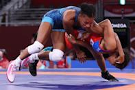 <p>Cuba's Laura Herin Avila (red) wrestles USA's Jacarra Gwenisha Winchester in their women's freestyle 53kg wrestling repechage match during the Tokyo 2020 Olympic Games at the Makuhari Messe in Tokyo on August 6, 2021. (Photo by Jack GUEZ / AFP)</p>