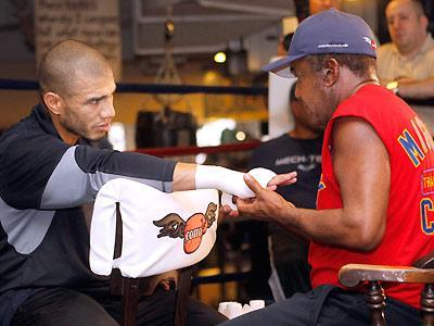 Miguel Cotto has his hands wrapped by trainer Emanuel Steward