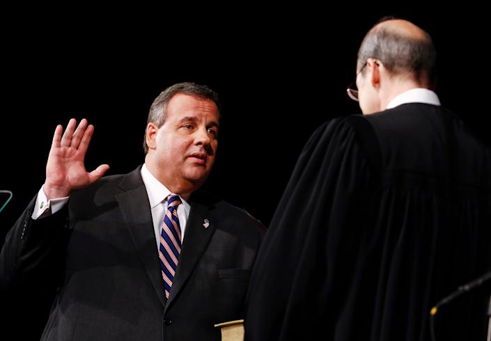 TRENTON, NJ - JANUARY 21: New Jersey Gov. Chris Christie (L) is sworn in by Chief Justice of the New Jersey Supreme Court Stuart Rabner for his second term on January 21, 2014 at the War Memorial in Trenton, New Jersey. Christie begins his second term amid controversy surrounding George Washington Bridge traffic and Hurricane Sandy relief distribution.  (Photo by Jeff Zelevansky/Getty Images)