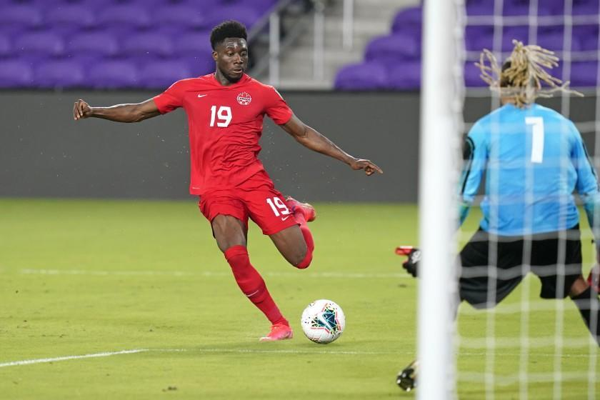 Canada forward Alphonso Davies (19) takes a shot on goal against Bermuda goal keeper Dale Eve (1) during the second half of a World Cup 2022 Group B qualifying soccer match, Thursday, March 25, 2021, in Orlando, Fla. (AP Photo/John Raoux)