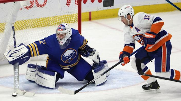Cal Clutterbuck denied by Sabres' Michael Houser