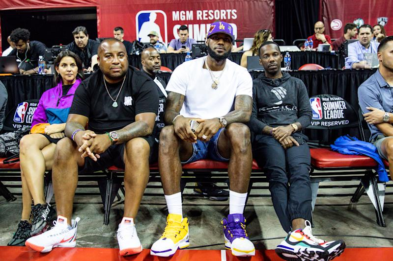 LAS VEGAS, NEVADA - JULY 05: (L-R) Ernie Ramos, LeBron James and Rich Paul sit court side at NBA Summer League on July 05, 2019 in Las Vegas, Nevada. NOTE TO USER: User expressly acknowledges and agrees that, by downloading and or using this Photograph, user is consenting to the terms and conditions of the Getty Images License Agreement. (Photo by Cassy Athena/Getty Images)