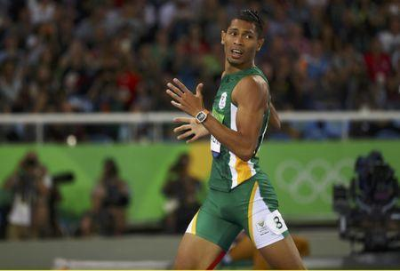 2016 Rio Olympics - Athletics - Final - Men's 400m Final - Olympic Stadium - Rio de Janeiro, Brazil - 14/08/2016. Wayde van Niekerk (RSA) of South Africa competes on the way to setting a new world record. REUTERS/Kai Pfaffenbach Picture Supplied by Action Images