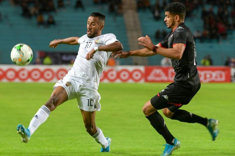 Star Libya forward Hamdou Elhouni (L) in action against Tunisia during a 2021 Africa Cup of Nations qualifier