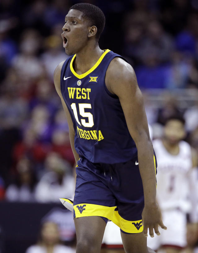 West Virginia's Lamont West celebrates after making a basket during the first half of an NCAA college basketball game against Texas Tech in the Big 12 men's tournament Thursday, March 14, 2019, in Kansas City, Mo. (AP Photo/Charlie Riedel)