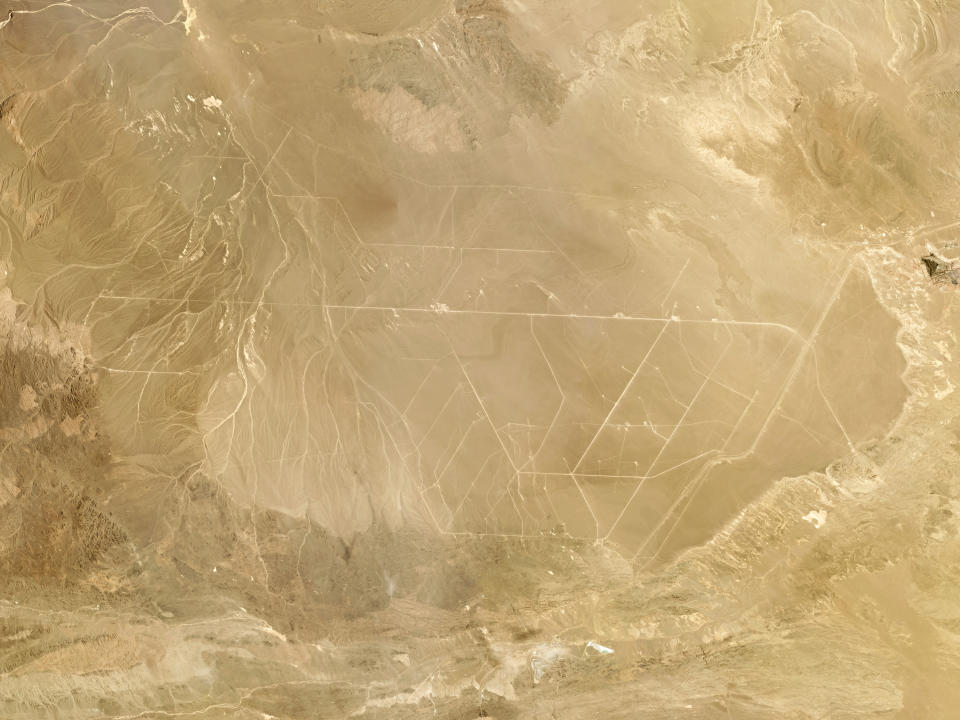This composite photo of satellite images taken in June 2021 provided by Planet Labs Inc. shows what analysts believe is a field of intercontinental ballistic missile silos near Hami, China. The U.S. military is warning about what analysts have described as a major expansion of China's nuclear missile silo fields, at a time of heightened tension between the U.S. and China. (Planet Labs Inc. via AP)