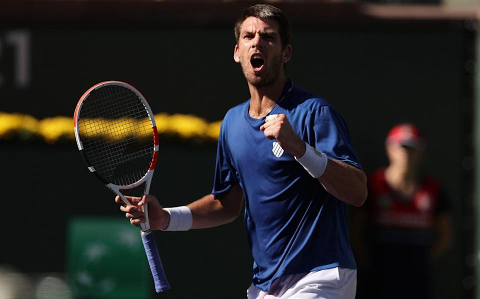 Cameron Norrie of Great Britain celebrates match point against Tommy Paul of the United States during their fourth round match on Day 10 of the BNP Paribas Open at the Indian Wells Tennis Garden on October 13, 2021 in Indian Wells, California - Getty Images North America