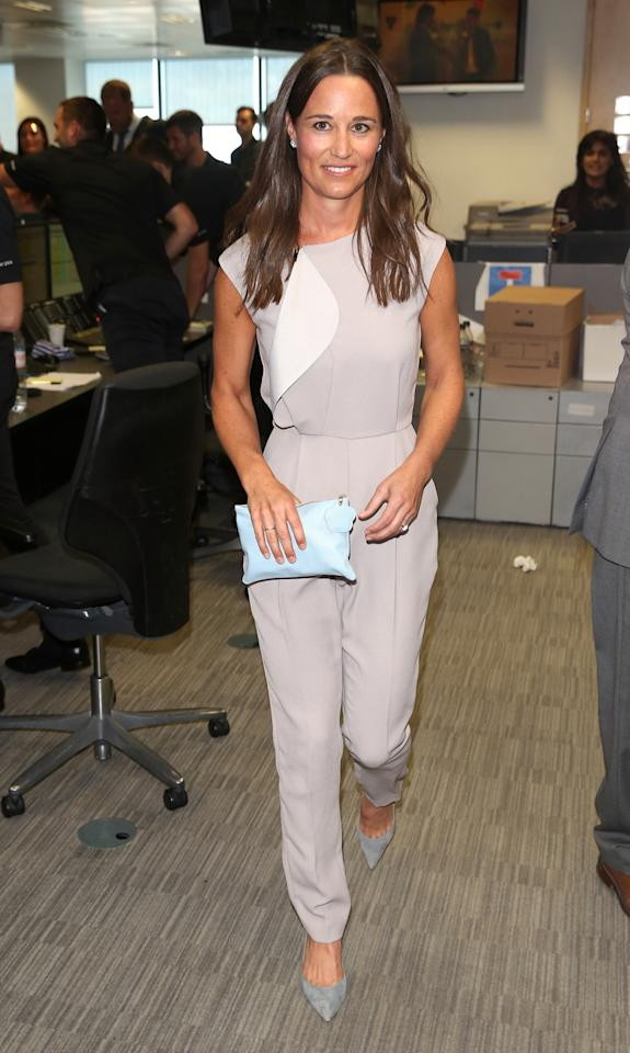 <p>Pippa manned the phones for a charity event wearing a tailored lilac jumpsuit and pointy grey heels. <i>[Photo: Getty]</i></p>