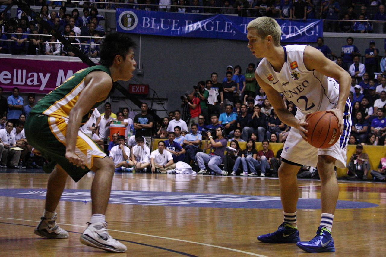 Terrence Romeo of FEU guards Kirk Long of Ateneo during the game 2 of the 74th Season of UAAP men's basketball championship series held at Smart Araneta Coliseum in Quezon City. (Marlo Cueto/NPPA Images)