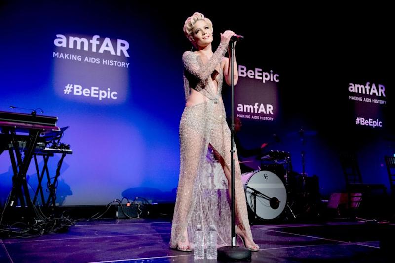 She was rocking a cut out, sheer, gold, crystalised gown for her performance. Source: Getty