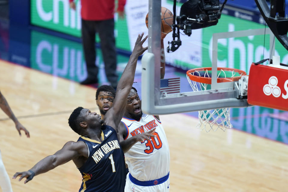 New York Knicks forward Julius Randle (30) goes to the basket against New Orleans Pelicans forward Zion Williamson (1) in the first half of an NBA basketball game in New Orleans, Wednesday, April 14, 2021. (AP Photo/Gerald Herbert)