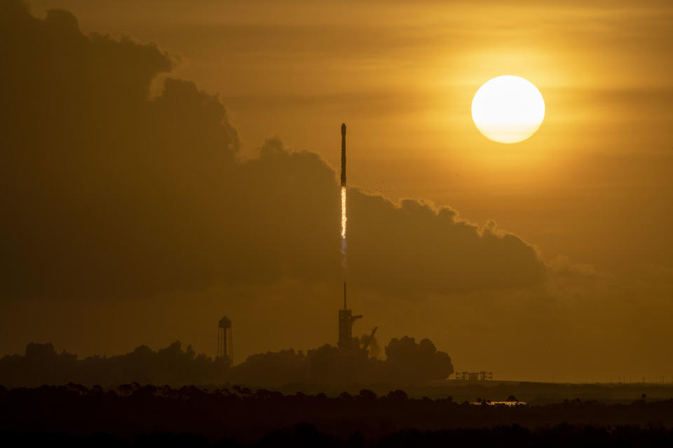 A SpaceX Falcon 9 rocket launches 60 Starlink internet satellites into space from Pad 39A of NASA's Kennedy Space Center in Cape Canaveral, Florida on Oct. 6, 2020. It was the third flight for the Falcon 9 booster.