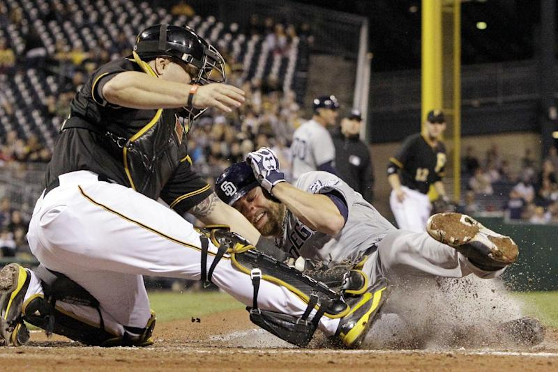 San Diego Padres' Andrew Cashner, right, scores ahead of the tag by Pittsburgh Pirates catcher Russell Martin, left,during the seventh inning of a baseball game against the Pittsburgh Pirates in Pittsburgh Monday, Sept. 16, 2013. Cashner scored from second on a single by Padres' Jedd Gyorko of Pittsburgh Pirates starting pitcher A.J. Burnett. (AP Photo/Gene J. Puskar)