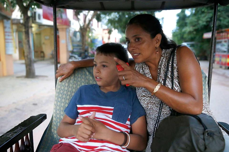 Mother and son visiting Cambodia.