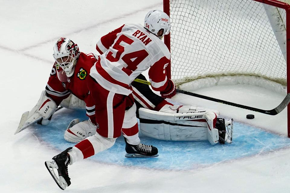 Detroit Red Wings' (54) Bobby Ryan scores against Chicago Blackhawks goaltender Kevin Lankinen in a shootout of an NHL preseason hockey game in Chicago, Wednesday, Sept. 29, 2021. The Red Wings won 4-3.