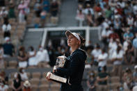 Czech Republic's Barbora Krejcikova holds the cup after defeating Russia's Anastasia Pavlyuchenkova in their final match of the French Open tennis tournament at the Roland Garros stadium Saturday, June 12, 2021 in Paris. The unseeded Czech player defeated Anastasia Pavlyuchenkova 6-1, 2-6, 6-4 in the final. (AP Photo/Thibault Camus)