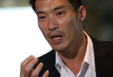 FILE PHOTO: Thanathorn Juangroongruangkit, founder of Thailand's Future Forward Party, speaks during an interview at the Reuters office in Bangkok, Thailand March 19, 2018. Picture taken March 19, 2018. REUTERS/Soe Zeya Tun/File Photo