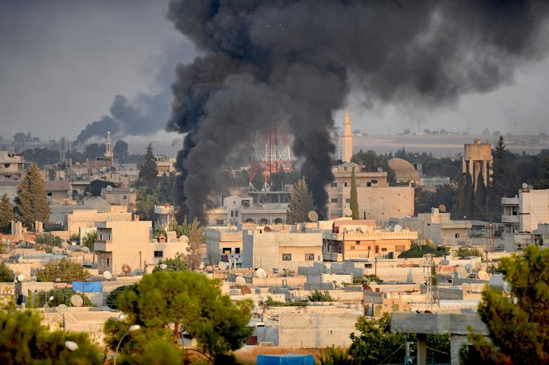 A photo taken from Turkey's Sanliurfa province, on Oct. 9, 2019 shows smoke rises at the site of Ras al-Ayn city of Syria as Turkish troops along with the Syrian National Army begin Operation Peace Spring in northern Syria against PKK/YPG, Daesh terrorists. (Photo: Kerem Kocalar/Anadolu Agency via Getty Images)