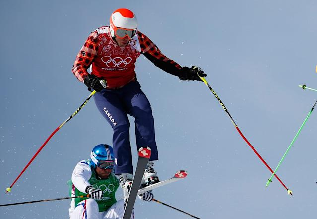 FILE PHOTO: Canada's David Duncan (top) performs a jump during the men's freestyle skiing skicross 1/8 final at the 2014 Sochi Winter Olympic Games in Rosa Khutor February 20, 2014. REUTERS/Dominic Ebenbichler/File Photo