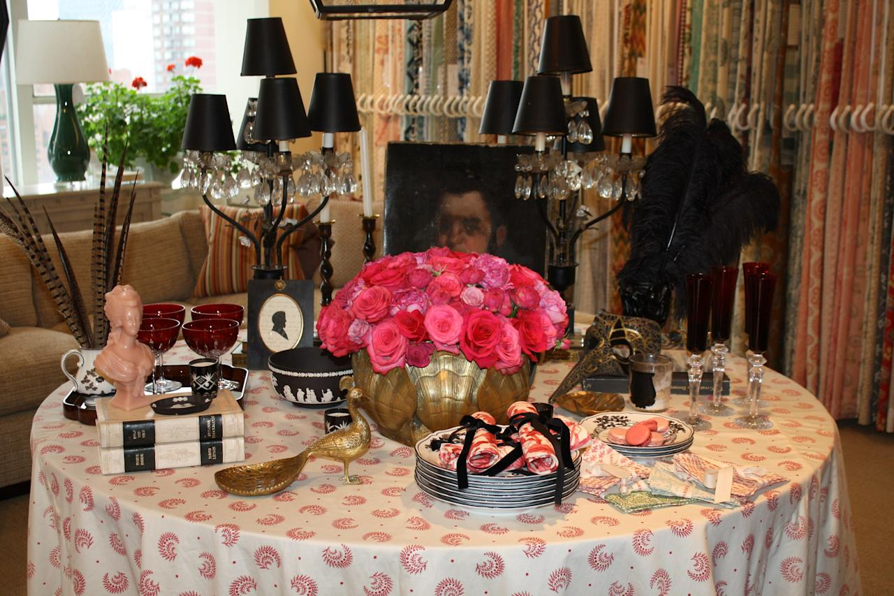 Sister Parish's Desmond print sets the scene for Jenny Wolf's tablescape, in which black and white accents are punctuated with pops of pink.