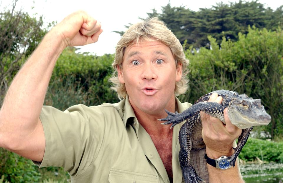 """""""The Crocodile Hunter"""", Steve Irwin, poses with a three foot long alligator at the San Francisco Zoo on June 26, 2002 in San Francisco, California"""