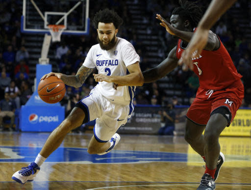Buffalo guard Jeremy Harris (2) drives into the lane against Miami of Ohio guard Jalen Adaway (3) during the first half of an NCAA college basketball game, Saturday, Jan. 12, 2019, in Buffalo N.Y. (AP Photo/Jeffrey T. Barnes)