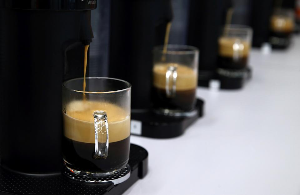 Coffees are poured for a tasting at the Nespresso production plant, part of food giant Nestle, in Romont, Switzerland, August 30, 2016. Picture taken August 30, 2016. REUTERS/Denis Balibouse