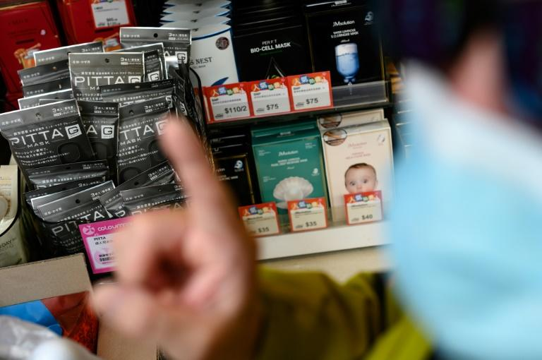 Masks are in short supply in Hong Kong, and getting to a shop that has them in stock can be tricky for wheelchair users (AFP Photo/Philip FONG)