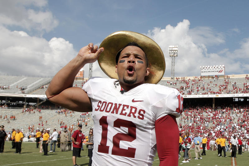 Oklahoma's Travis Lewis (12) dons the golden sombrero and celebrates after beating Texas 55-17 in an NCAA college football game at the Cotton Bowl in Dallas, Saturday, Oct. 8, 2011.  (AP Photo/Brandon Wade)