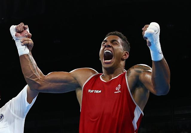 2016 Rio Olympics - Boxing - Final - Men's Super Heavy (+91kg) Final Bout 273 - Riocentro - Pavilion 6 - Rio de Janeiro, Brazil - 21/08/2016. Tony Yoka (FRA) of France celebrates after winning his bout. REUTERS/Peter Cziborra FOR EDITORIAL USE ONLY. NOT FOR SALE FOR MARKETING OR ADVERTISING CAMPAIGNS.