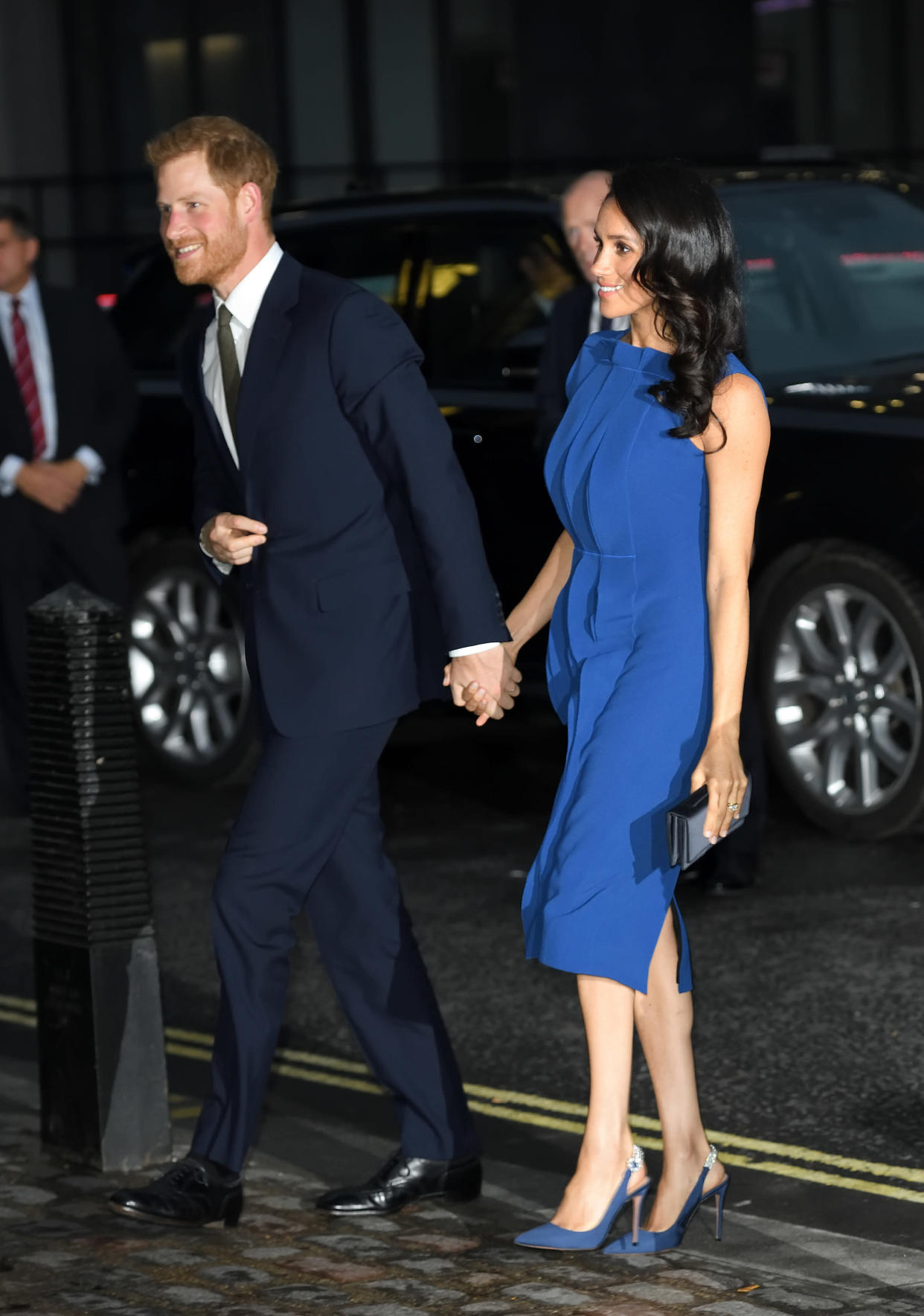 Prince Harry and the Duchess of Sussex arrive at the 100 Days of Peace in London. (Photo: Getty Images)