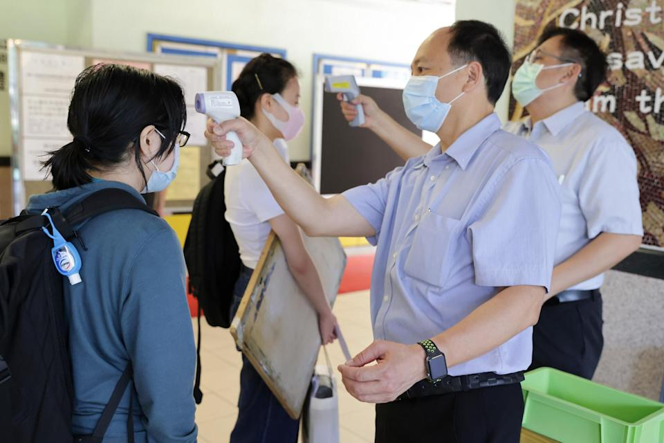 Students have their temperatures checked before sitting a DSE exam at Gertrude Simon Lutheran College in Yuen Long. Photo: May Tse