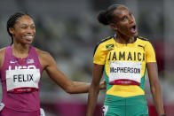 Stephenie Mcpherson, right, of Jamaica, reacts after winning a women's 400-meter semifinal as Allyson Felix, of the United States, looks on, at the 2020 Summer Olympics, Wednesday, Aug. 4, 2021, in Tokyo. (AP Photo/Petr David Josek)