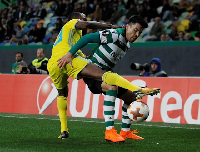 Soccer Football - Europa League Round of 32 Second Leg - Sporting CP vs Astana - Estadio Jose Alvalade, Lisbon, Portugal - February 22, 2018 Sporting's Marcos Acuna in action with Astana's Patrick Twumasi REUTERS/Rafael Marchante