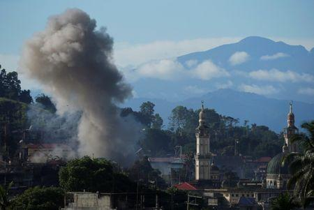 An explosion is seen after Philippines army airstrike as government troops continue their assault against insurgents from the Maute group in Marawi City, Philippines June 28, 2017. REUTERS/Jorge Silva