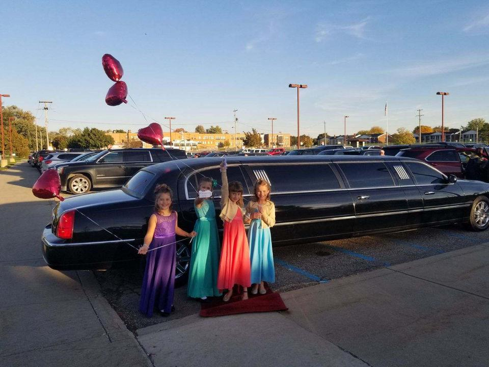 The girls standing in front of their surprise limo holding balloons in honor of Luke Reece. (Photo: Courtesy of Steve Culbert)