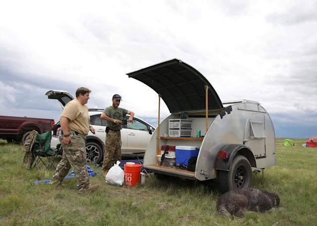 <p>Members of self-described patriot groups and militias stow equipment in their camper during III% United Patriots' Field Training Exercise outside Fountain, Colo., July 29, 2017. (Photo: Jim Urquhart/Reuters) </p>