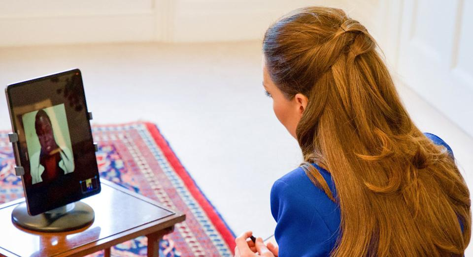 Kensington Palace shared a picture of the duchess interviewing the midwife. (Kensington Palace)