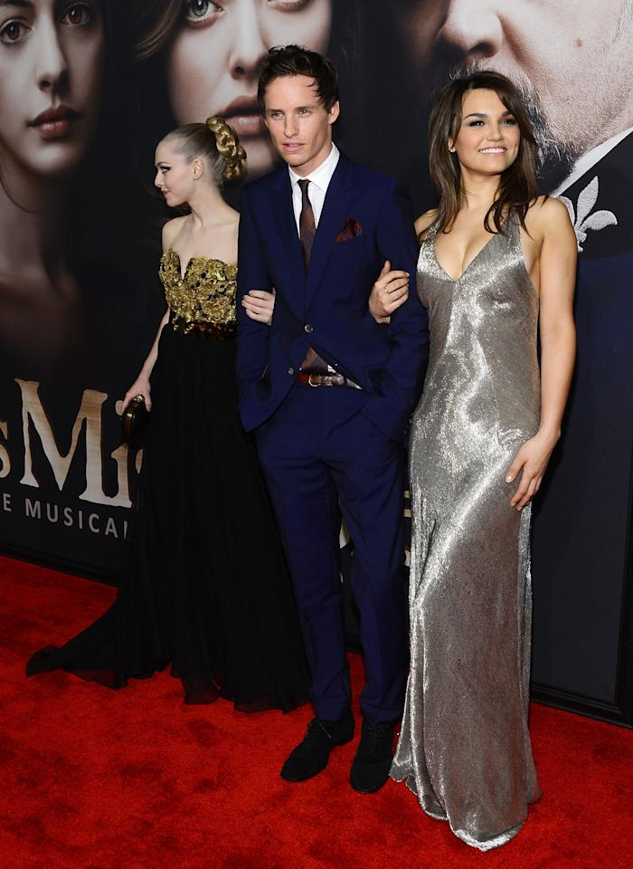 """NEW YORK, NY - DECEMBER 10:  (L-R) Amanda Seyfried, Eddie Redmayne, and Samantha Barks attend the """"Les Miserables"""" New York premiere at Ziegfeld Theater on December 10, 2012 in New York City.  (Photo by Larry Busacca/Getty Images)"""