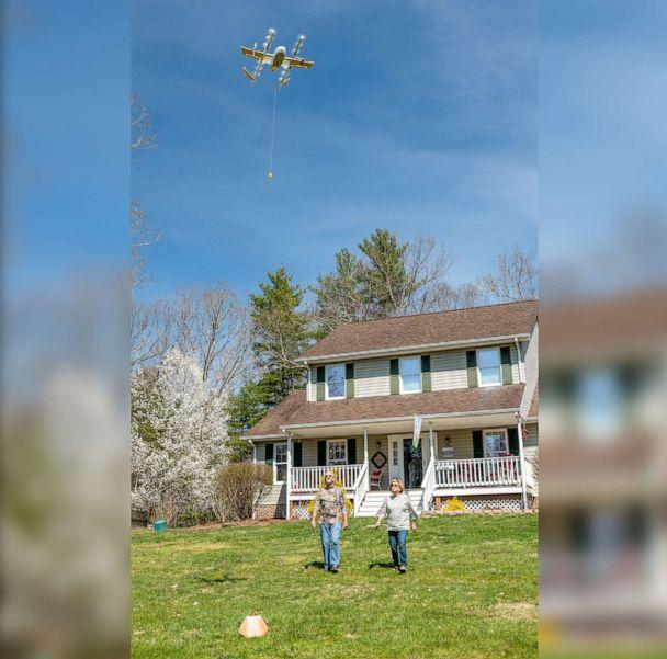 PHOTO: A Virginia family receives an air delivery by drone as part of Wing's validation testing with the FAA in an undated handout photo. (Wing)