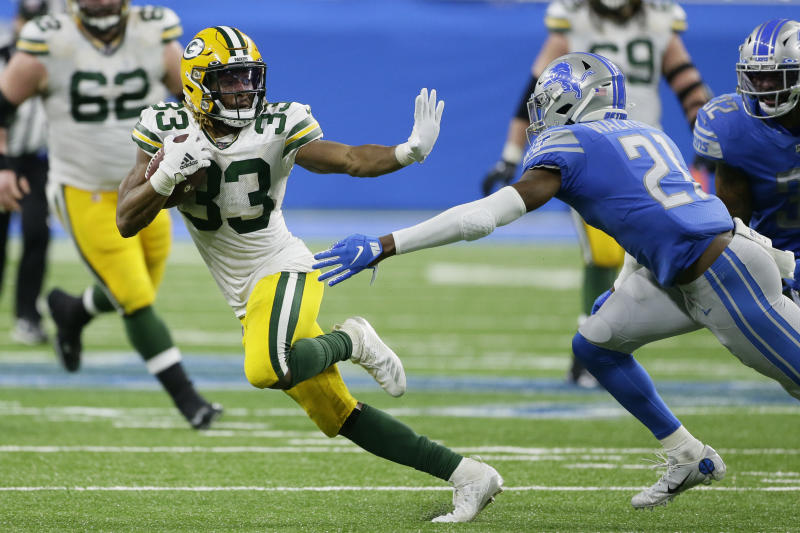 Green Bay Packers running back Aaron Jones (33) breaks away from Detroit Lions free safety Tracy Walker (21) during the second half of an NFL football game, Sunday, Dec. 29, 2019, in Detroit. (AP Photo/Duane Burleson)