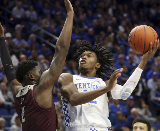 Kentucky's Keion Brooks Jr., right, shoots while pressured Eastern Kentucky's Tre King during the first half of an NCAA college basketball game in Lexington, Ky., Friday, Nov. 8, 2019. (AP Photo/James Crisp)