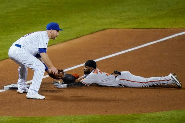 Orioles hit four homers, beat Mets 11-2