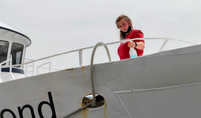 An employee with The Vagabond Cruise sanitizes touch points on Saturday, June 27, 2020 at Harbour Town in Sea Pines on Hilton Head Island after a sight seeing group on the vessel returned to the pier.