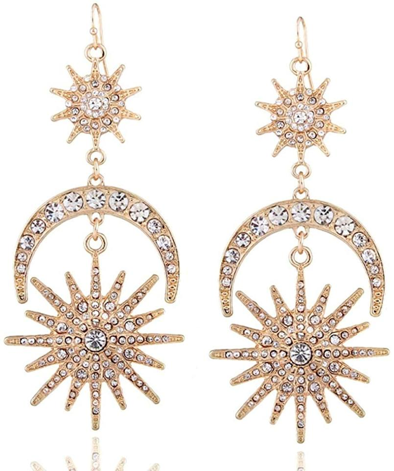 "<p>These <a href=""https://www.popsugar.com/buy/Sun-Moon-Stars-Drop-Earrings-523534?p_name=Sun%20Moon%20Stars%20Drop%20Earrings&retailer=amazon.com&pid=523534&price=11&evar1=fab%3Aus&evar9=46980893&evar98=https%3A%2F%2Fwww.popsugar.com%2Ffashion%2Fphoto-gallery%2F46980893%2Fimage%2F46980975%2FSun-Moon-Stars-Drop-Earrings&list1=shopping%2Camazon%2Choliday%2Cnew%20years%20eve%2Choliday%20fashion%2Cfashion%20shopping&prop13=mobile&pdata=1"" rel=""nofollow"" data-shoppable-link=""1"" target=""_blank"" class=""ga-track"" data-ga-category=""Related"" data-ga-label=""https://www.amazon.com/Exaggerated-Earrings-Rhinestone-Jewelry-Statement/dp/B07FMCSJHJ/ref=ya_st_pd_dx_rtpb_11?_encoding=UTF8&amp;pd_rd_i=B07FMCSJHJ&amp;pd_rd_r=3543e8d3-8084-45ac-a4b7-abdee5bf789d&amp;pd_rd_w=v38Uo&amp;pd_rd_wg=jLWTr&amp;psc=1&amp;refRID=1NC9GMTR77239ZPSY5WD"" data-ga-action=""In-Line Links"">Sun Moon Stars Drop Earrings</a> ($11) are so dreamy.</p>"