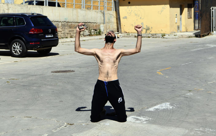 A man from Morocco reacts after entering swimming into the Spanish territory, at the Spanish enclave of Ceuta on Monday, May 17, 2021. Authorities in Spain say that around 1,000 Moroccan migrants have crossed into Spanish territory (Antonio Sempere/Europa Press via AP)