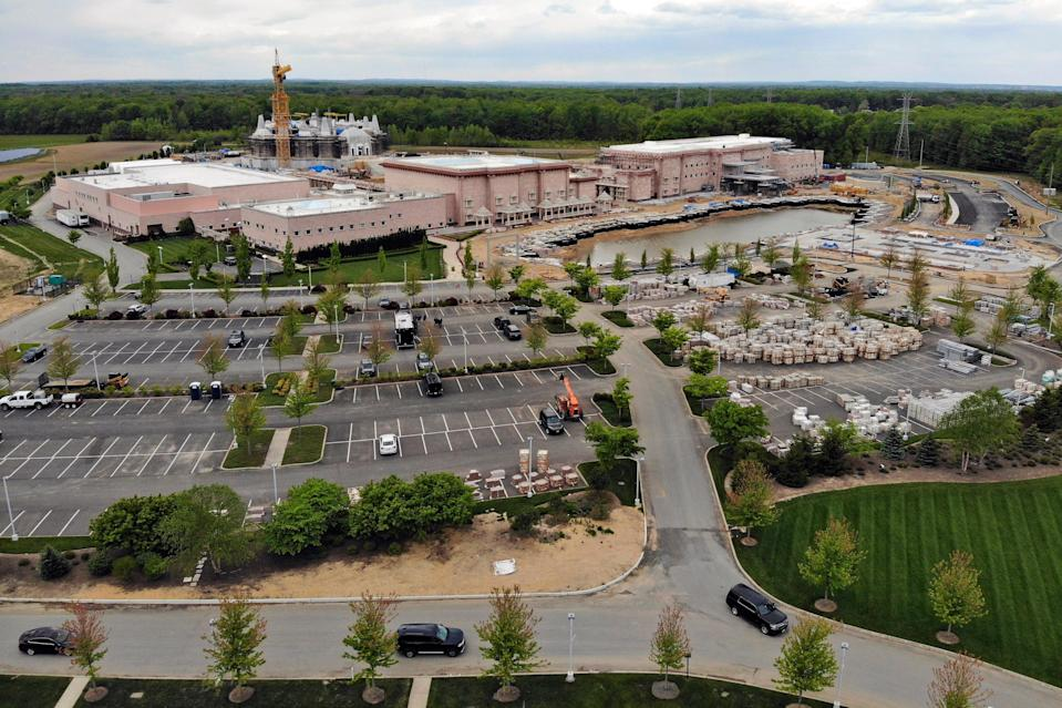 <p>A view of the BAPS Shri Swaminarayan Mandir in Robbinsville Township, New Jersey, on 11 May, 2021. A lawsuit claims workers from marginalized communities in India were lured to New Jersey and forced to work more than 12 hours per day at slave wages to help build a Hindu temple</p> (AP)