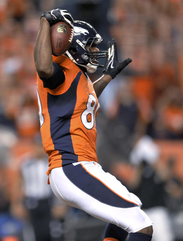 Denver Broncos tight end Julius Thomas celebrates his touchdown against the Baltimore Ravens during the first half of an NFL football game, Thursday, Sept. 5, 2013, in Denver. (AP Photo/Jack Dempsey)